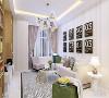 客厅的沙发背景墙照片采用的是黑白的设计使墙面看起来更加时尚。沙发采用得是白色的布艺沙发,搭配彩色花纹的抱枕。