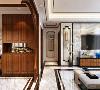 客厅的设计比较简单,沙发背景墙放了3幅装饰画,使空间更为大气,吊顶的设计做了回字形吊顶石膏板并藏有灯带,沙发的选择为布质的,茶几选择为方形。