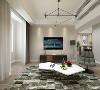 在客厅的设计中采用奶咖色的墙面乳胶漆,沙发采用浅灰色的布艺沙发,用橘色抱枕点缀,沙发背景墙用简单的装饰画装饰,电视柜用深棕色木纹电视柜来压制整个空间。