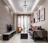 现代风格以灰色为基调,橙色沙发和抱枕让整个空间看起来不那么压抑;电视墙采用1200X600砖上墙,配合黑白烤漆电视柜,使整个客厅的空间显得宽阔和大气。