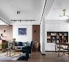 客厅与书房空间的通透设计,使原本各自独立的区域得到了视觉的延伸和空间的享受,整个空间更加宽敞、明亮。