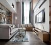 户型净高4.7米,充分利用挑高空间的视觉效果,配合整扇的采光窗,在客厅做了很多由顶置地的造型,储物。