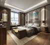 卧室的色彩搭配上摒弃单纯的色调,深色的点缀使得整个空间更加沉稳,点光源的大量使用,也成了现代装饰手法的一大特点,让居室生活氛围更具轻松惬意。