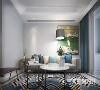 灰色调的布艺沙发、多彩素色的地毯,整体给人现代舒适又富有活力的感觉。
