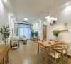 """客厅装修:客厅的色彩基调是白色和原木色,白墙落地+木质家具,局部用绿植添加一丝活力,这些自然素材的""""和谐""""让整个大空间显得自然且淡雅。"""