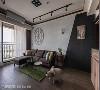 客厅 客厅主墙面以仿清水模壁面搭配斜面慕丝水泥板喷黑,挂上质感壁画隐藏电箱,两相衔接延伸工业风,也不压迫整体视觉。