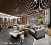 """住宅的艺术性 沙发旁规划成宴客区,水泥吊灯与钢刷木皮成为主题映衬绿意,订制的象形""""亚""""字茶几搭配高矮错置的摆饰,在机能之外强化了艺术性。"""