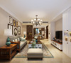 客厅的设计亮点主要在灯光和颜色的搭配上,由于沙发、茶几、电视柜是由于家具,为了让这样家具融入进来,电视背景墙定制的书柜颜色为白色,可以跟电视柜完美结合