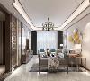 客厅部分采光较好,地面色调为白色、浅灰色、金色线条结合,客厅区域背景墙为硬包材质、镶上金属线条,更显整体档次与气质。