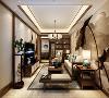 客厅区选用的是深色的原木色家具,配饰上用的是米白色的饰面。在茶几上还摆放普蓝色的釉面瓷器,台灯的浅蓝色也是与餐厅的浅蓝色相对应,再摆上几株绿植,让空间多一些生机。整体搭配起来使整个空间充满古典的韵味。