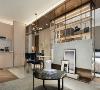 空间布局 毛丝面的镀钛金属由玄关贯穿左右,横向展开的设计扮演稳定与平衡的角色,自然地带出厨房、客厅与寝室三场域融合的美妙关系。