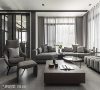 灰阶空间 家具家饰配置斜向的沙发辅以方、圆造型茶几来引导并满足动线上的流畅。厨房门片结合铁件与玻璃增加光线与气流的通透性,保有视觉穿透。