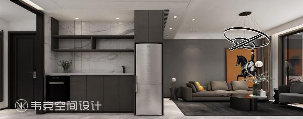 """无拉手餐边柜的设计带来了惊喜,将可能导致餐厨空间杂乱的一些物件收纳起来""""隐藏""""到柜体中,带来空间的干净整洁及视觉上的愉悦感。"""