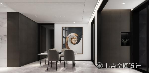 墙上的装饰画与餐厅氛围浑然一体,展现出居住者优雅的生活态度。玄关收纳柜极致而富有艺术情调,时光慢慢,用心享受生活的每一个细节。