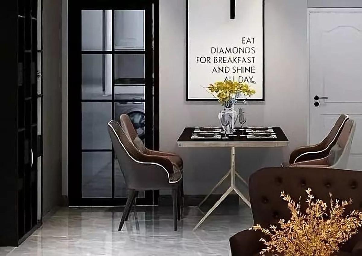 餐厅位于入门玄关侧一角,金色包裹黑色方桌,一面简约挂画,没有过多的装饰