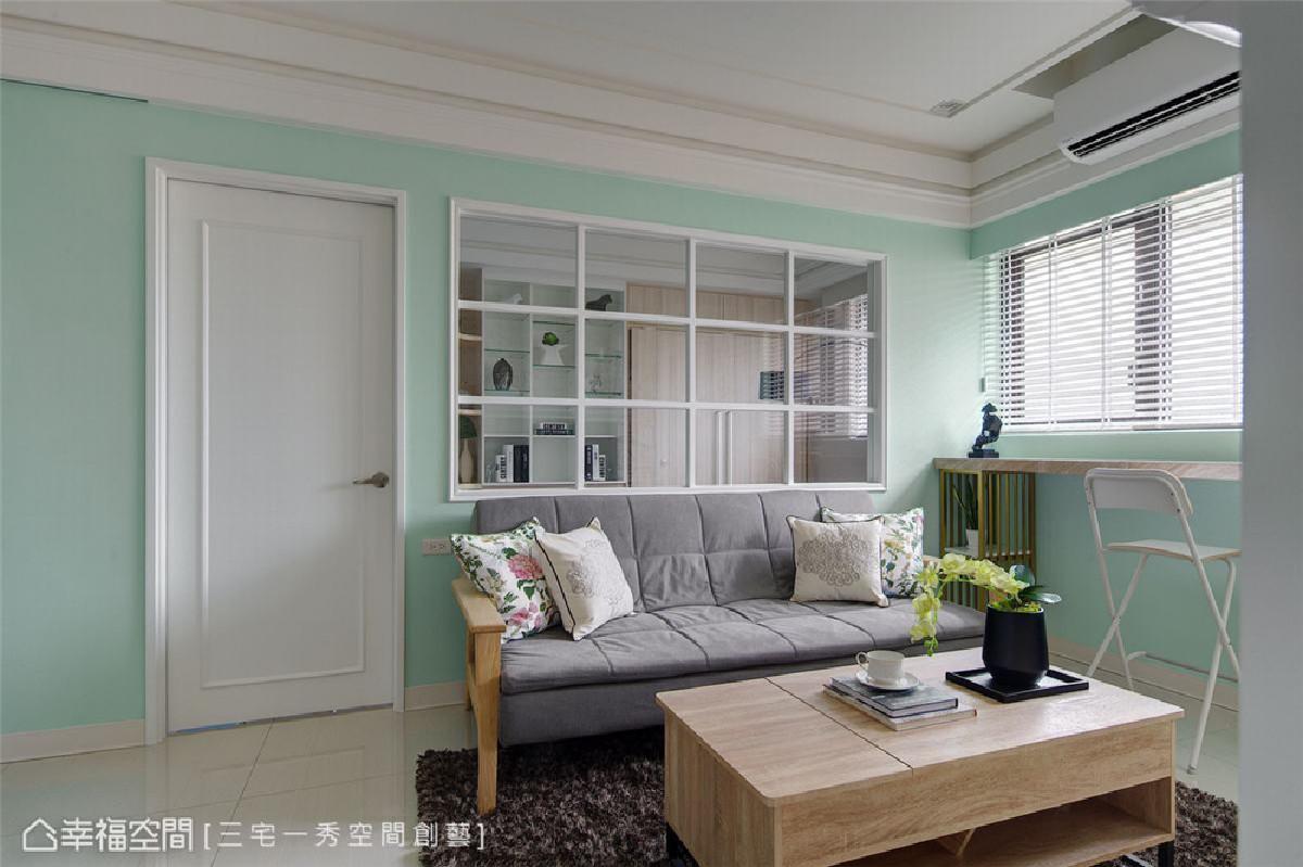 客厅 以马卡龙薄荷绿为空间基底,再添入深色绒毛地毯挹注内敛沉稳质蕴,构画清新优雅的美好生活想像。