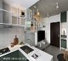 L型厨房 在小坪数的空间中,利用L型厨房作为区隔场域的界限,同时增加的台面空间可当作简易吧台使用。