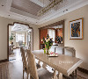 莫兰迪色系的餐桌椅成为空间中心,不鲜亮却自带高级感。顶面用几何图形构建成立体对称的顶部造型,地面花砖的细腻风采以及手工贴砖的细致