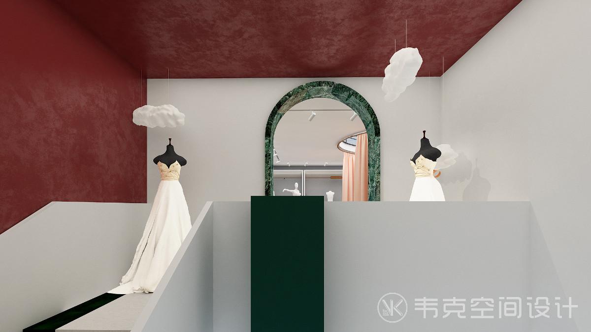 沿着楼梯拾级而上,行至二楼映入眼帘的是婚纱展示区域,拱形门与古典绿的结合,给人带来一种春暖花开的期待感,层次分明的色调铺展,为空间注入永不过时的时尚气息。