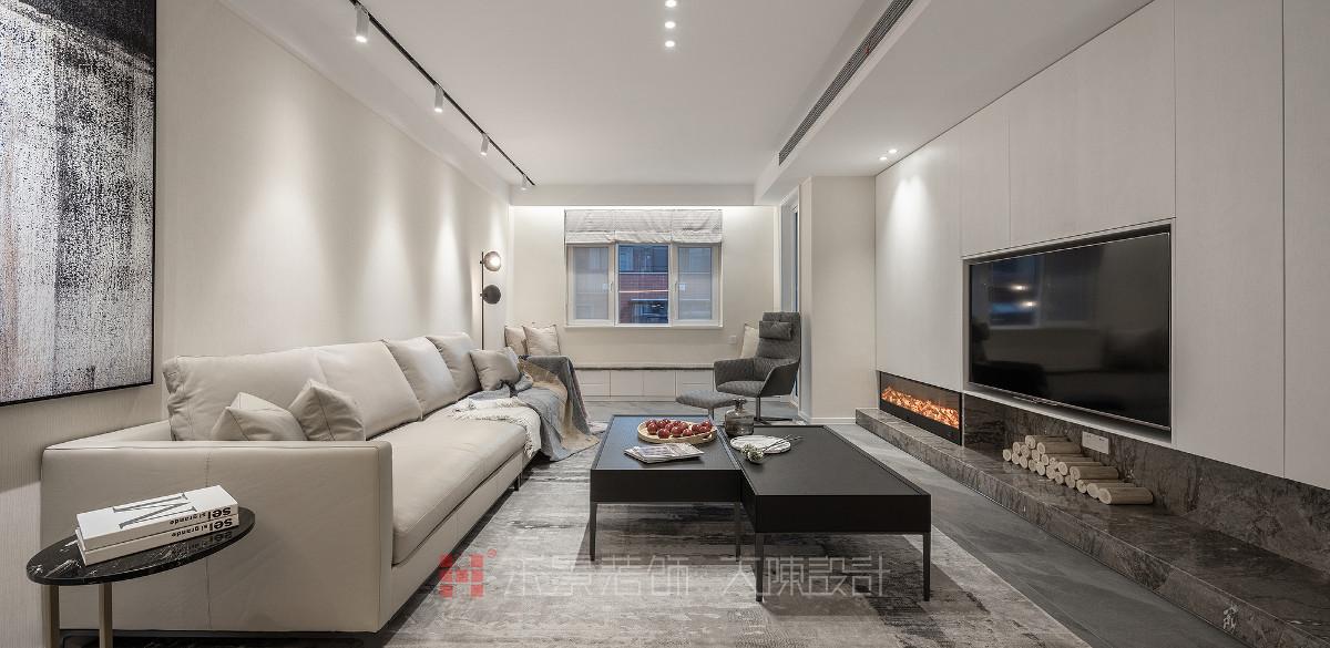 客厅采用轻快自然的手法,木饰面配上大理石,营造时尚优雅的气质,浅色调的真皮沙发让家具的温润感突显出来,表达了居住者平和内敛的态度。